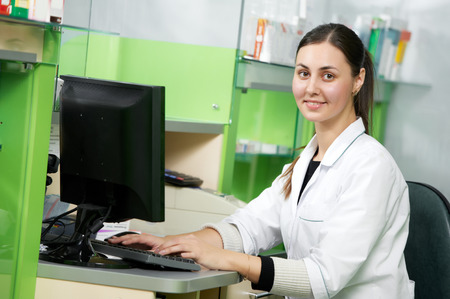 experienced: pharmacist chemist woman working in pharmacy drugstore with doctor prescription