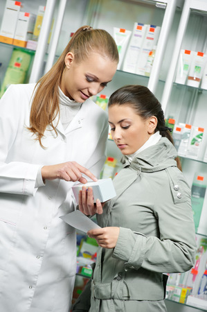 suggesting: pharmacist suggesting medical drug to buyer in pharmacy drugstore