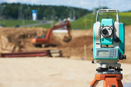 leveler: Surveyor equipment tacheometer or theodolite outdoors at construction site Stock Photo