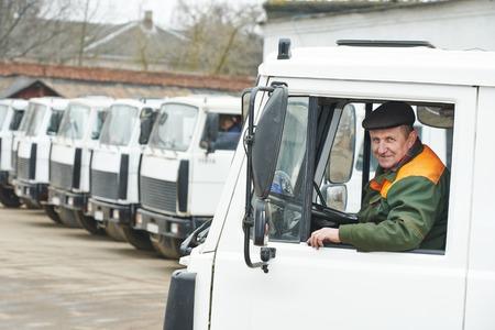 dumper: industrial dumper truck driver at vehicle automobile company autopark