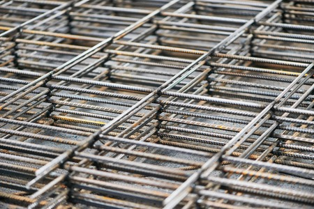reinforcing: heap of metal steel reinforcing rods lattice background Stock Photo