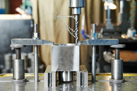 rapid steel: Close up machining tool drill during metal cutting process boring a hole Stock Photo