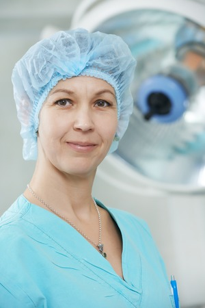 cardiosurgery: Portrait of surgeon nurse or doctor in uniform during cardiological operation on a patient at cardiac surgery clinic Stock Photo