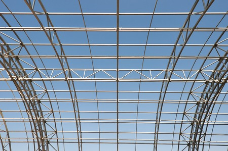 modern frame work of metal construction carcass roof support of building photo