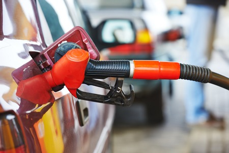 fueling: Fuel theme. dispenser pumping diesel or gasoline in car at gas station Stock Photo