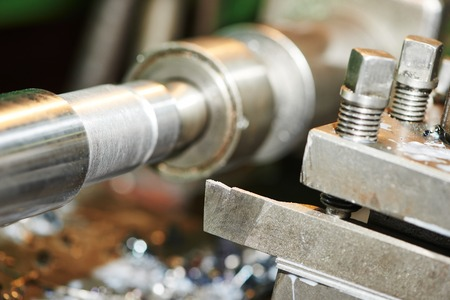 cutting tool: industrial metal work machining process of shaft by cutting tool on lathe