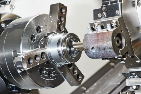 lathe: industrial metal work bore machining process by cutting tool on automated lathe