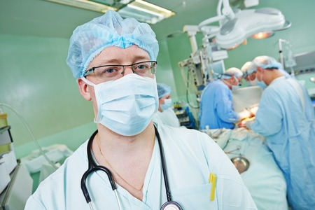 cardiosurgery: anaesthesiologist doctor in uniform preparing narcosis anaesthesia during heart transplantation operation at cardiac surgery clinic