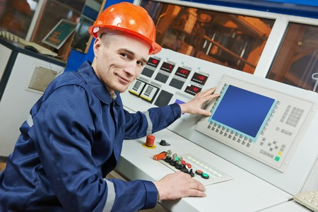 switchboard: industrial engineer worker operating control panel system at modern manufacture plant