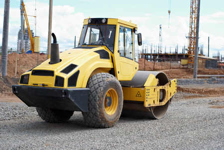 compacting: Heavy vibration roller compactor at compaction pavement works during road repairing or construction