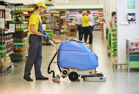 man machine: Floor care and cleaning services with washing machine in supermarket shop store