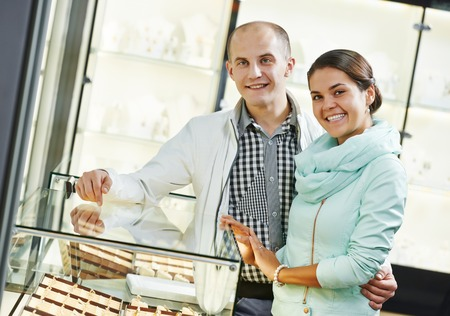 Young happy couple together selecting gift at jewelry boutique shop Stock Photo - 27844984