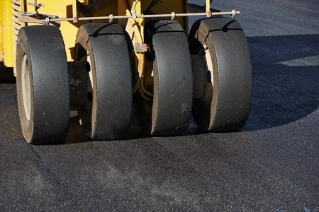 vibroroller: Pneumatic tyred roller compactor at asphalt pavement works for road repairing