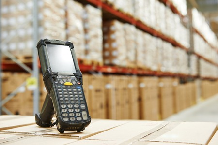 wireless: Bluetooth barcode scanner in front of modern warehouse
