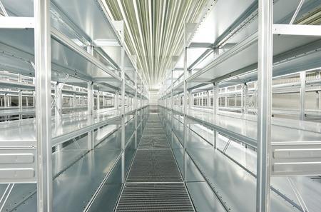 New modern metal warehouse shelves construction photo