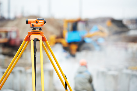 exact position: Surveyor equipment optical level or theodolite outdoors at construction site Stock Photo