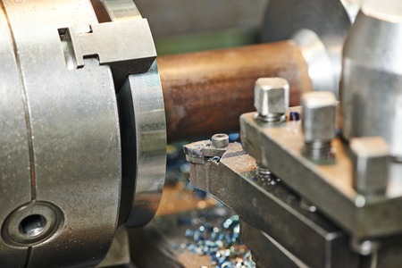 rapid steel: industrial metal work machining process of shaft by cutting tool on lathe