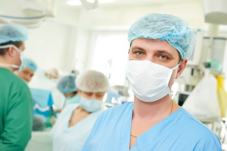 cardiosurgery: surgeon in uniform after surgery operation at clinic operating room Stock Photo