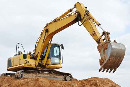 loader: excavator machine at excavation earthmoving work in sand quarry Stock Photo