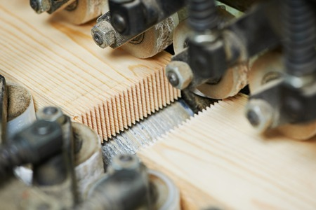 Wood plank finger jointing process on factory manufacture production line photo