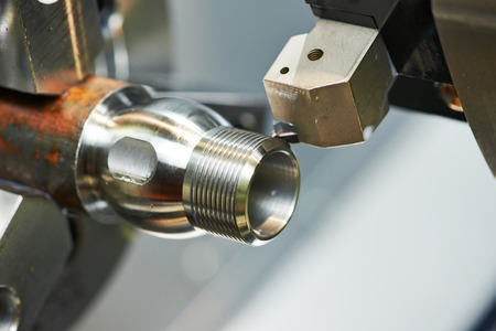 milling detail on metal cutting machine tool at factory photo