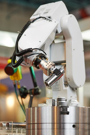 Robotics. Mechanical precision arm of robot manipulator with detail during positioning at facory photo
