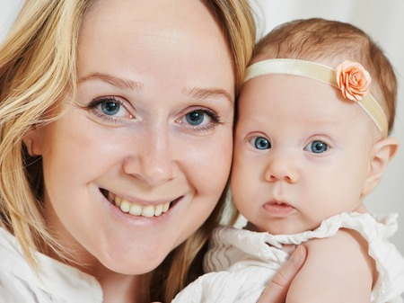 baby of three month with mother hapy portrait Stock Photo - 28685473