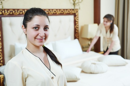 Hotel service. female housekeeping workers at inn room photo