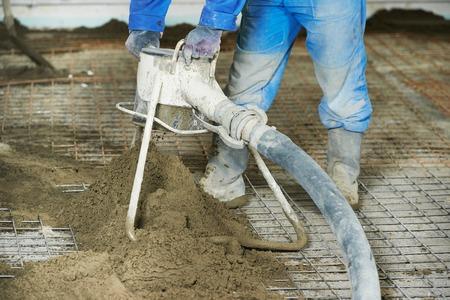 floor covering: Plasterer at indoor floor concrete cement covering