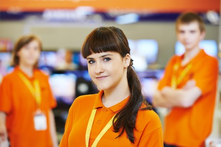 Positive team of shop assistants in supermarket store Stok Fotoğraf