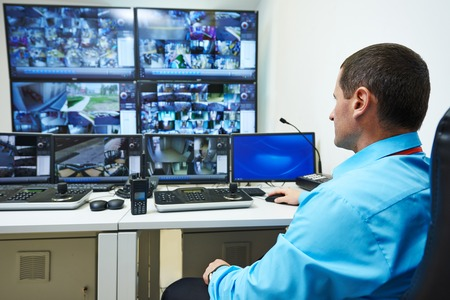 monitoring: security guard watching video monitoring surveillance security system Stock Photo
