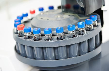 chemical industry: Close-up laboratory flasks with pharmacy medicine drag in cartridge. Shallow DOF