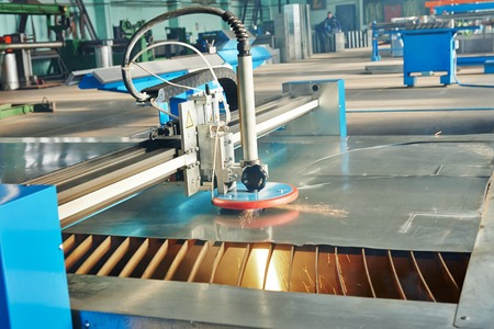 laser beam: Industrial laser or plasma cutting processing manufacture technology of flat sheet metal steel material with sparks Stock Photo