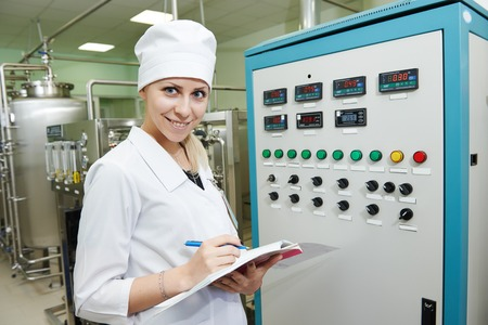 pharmaceutical factory woman worker operating water preparation production line at pharmacy industry manufacture factory photo