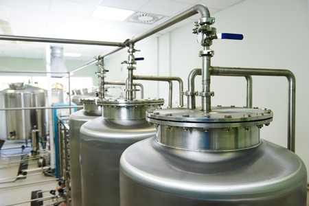 filtration: Pharmaceutical technology equipment tank facility for water preparation, cleaning and treatment at pharmacy plant Stock Photo