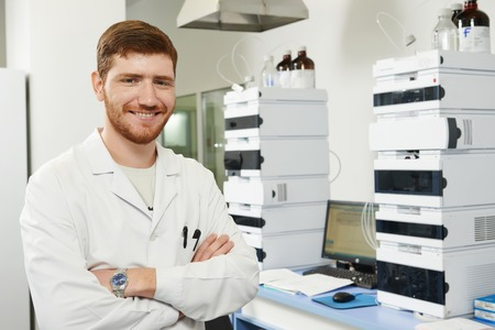 researcher man at scientific analysing work in chemistry laboratory photo