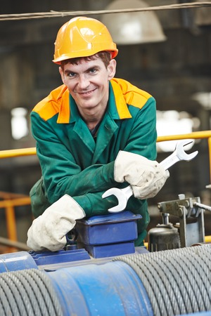metalworker: smiling industrial worker with spanner at factory workshop Stock Photo