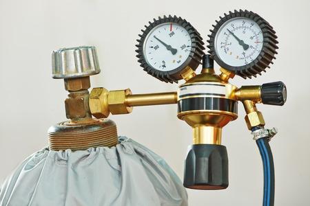 regulators: welding equipment acetylene gas cylinder tank with gauge regulators manometers