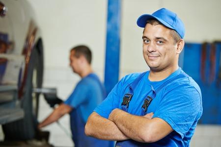 auto mechanic: repairman auto mechanic Portrait in car auto repair or maintenance shop service station Stock Photo