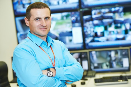 security room: security executive chief in front of video monitoring surveillance security system