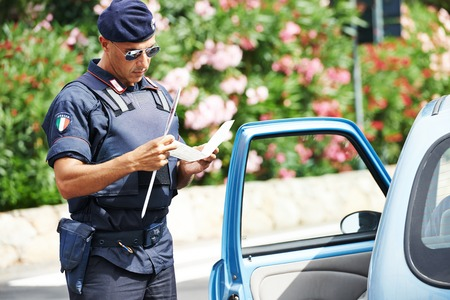 Italian special military police force carabinier checking driving documents Stock Photo