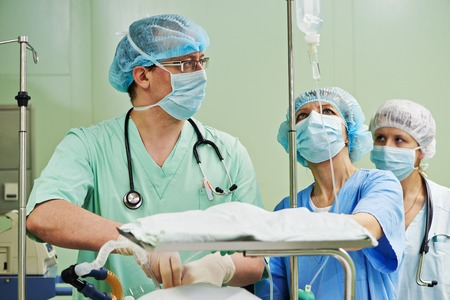 cardiosurgery: surgeons in uniform in operation room at cardiac surgery clinic