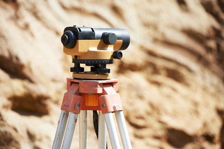 leveler: Surveyor equipment optical level or theodolite outdoors at construction site Stock Photo