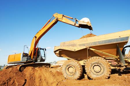 dumper: wheel loader excavator machine loading dumper truck at sand quarry