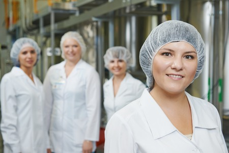 setup operator: portrait of female pharmaceutical factory worker in pharmacy industry manufacture factory