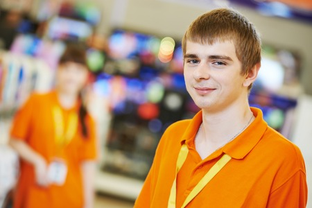 job market: Positive team of shop assistants in supermarket store Stock Photo