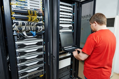 security room: network engineer working in server room