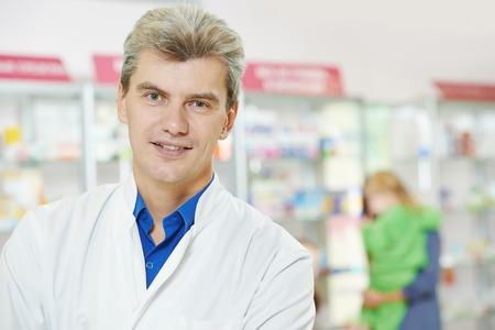 cheerful pharmacist chemist man in pharmacy drugstore photo