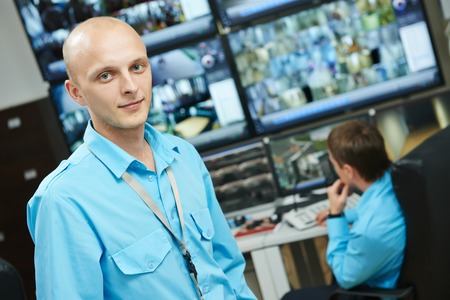 security room: Portraits of security guard over video monitoring surveillance security system Stock Photo