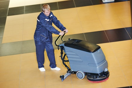 machines: Floor care and cleaning services with washing machine in business centre hall